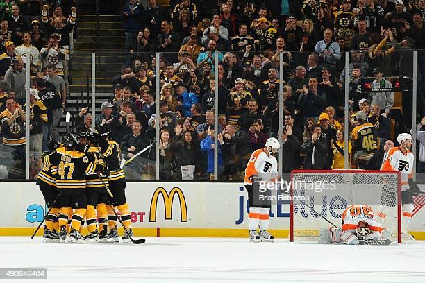 Players of the Boston Bruins celebrate a goal against the Philadelphia Flyers at the TD Garden on October 21 2015 in Boston Massachusetts