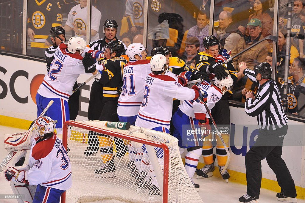 Players of the Boston Bruins in a scuffle behind the net against the Montreal Canadiens at the TD Garden on March 3, 2013 in Boston, Massachusetts.