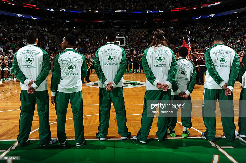 Players of the Boston Celtics observe the national anthem before the game against the Utah Jazz on November 6, 2013 at the TD Garden in Boston, Massachusetts.