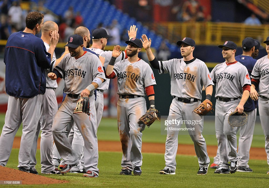 Players of the Boston Red Sox celebrate after a 14-inning, 10 - 8 win against the Tampa Bay Rays June 10, 2013 at Tropicana Field in St. Petersburg, Florida.