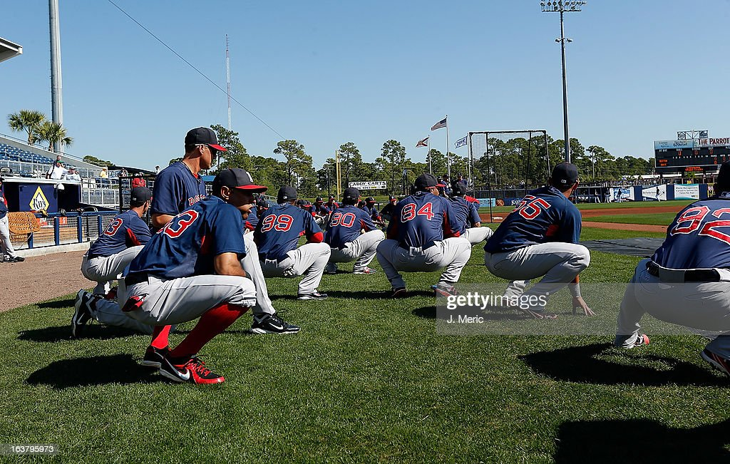 Players of the Boston Red Sox stretch just before the start of the Grapefruit League Spring Training Game against the Tampa Bay Rays at the Charlotte Sports Complex on March 16, 2013 in Port Charlotte, Florida.