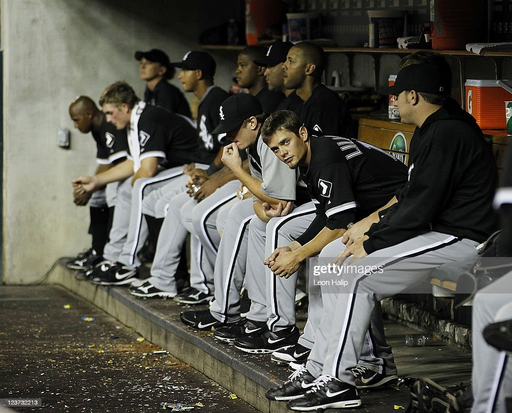 Players of the Chicago White Sox sit in the dugout during the game against the Detroit Tigers, after the Tigers scored 16 runs on 22 hits in the first sixth innings of the game at Comerica Park on September 4, 2011 in Detroit, Michigan.