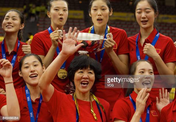 Players of the Chinese national women's volleyball team pose with their trophy during the award ceremony of the 2017 FIVB Volleyball Women's World...