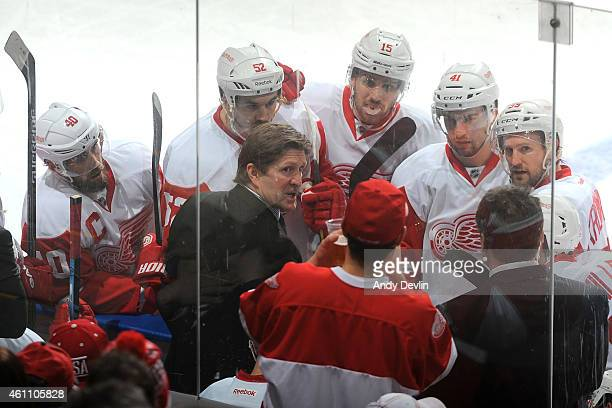 Players of the Detroit Red Wings listen to coach Mike Babcock during a time out in a game against the Edmonton Oilers on January 6 2015 at Rexall...