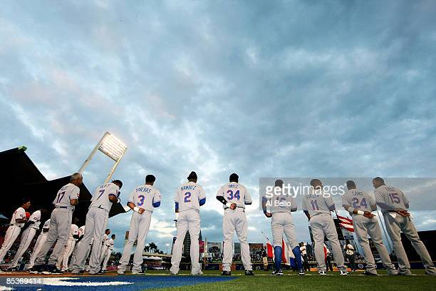 Players of the Dominican Republic stand for the national anthem before the game against the Netherlands during the 2009 World Baseball Classic Pool D...