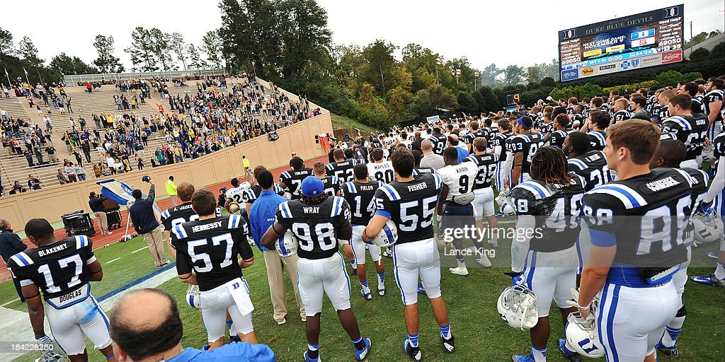 Players of the Duke Blue Devils gather with players of the Navy Midshipmen as Navy and their fans sing Blue and Gold at Wallace Wade Stadium on October 12, 2013 in Durham, North Carolina. Duke defeated Navy 35-7.