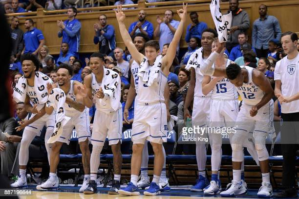 Players of the Duke Blue Devils react from their bench during their game against the St Francis Red Flash at Cameron Indoor Stadium on December 5...