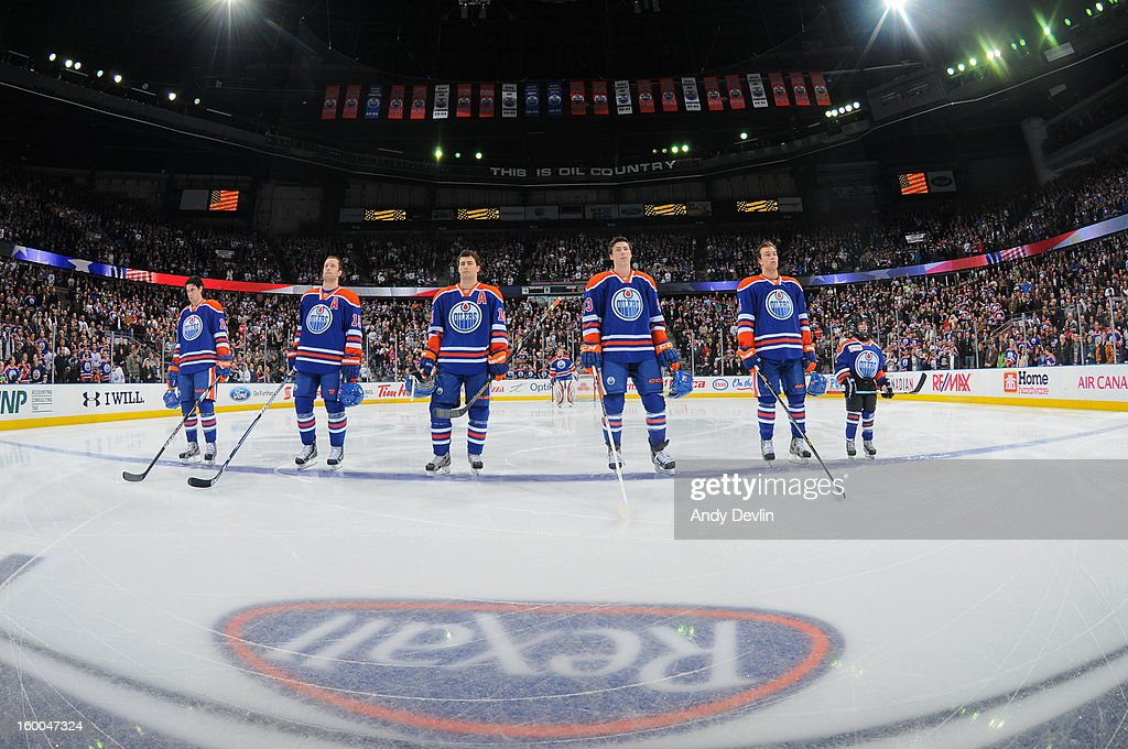 Players of the Edmonton Oilers line up for the singing of the national anthem prior to a game against the Los Angeles Kings at Rexall Place on January 24, 2013 in Edmonton, Alberta, Canada.