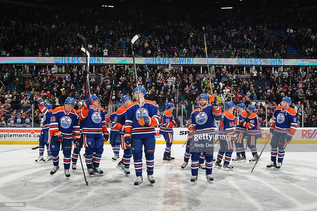 Players of the Edmonton Oilers salute the crowd after a game against the Nashville Predators on March 17, 2013 at Rexall Place in Edmonton, Alberta, Canada.