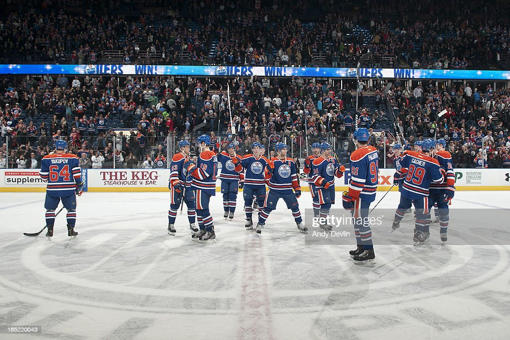 Players of the Edmonton Oilers salute the crowd after winning the game against the Calgary Flames on April 1, 2013 at Rexall Place in Edmonton, Alberta, Canada.