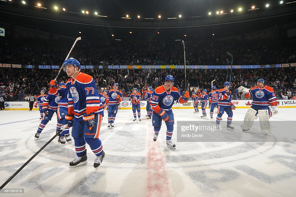 Players of the Edmonton Oilers salute the crowd after winning the game against the Florida Panthers on November 21, 2013 at Rexall Place in Edmonton, Alberta, Canada.
