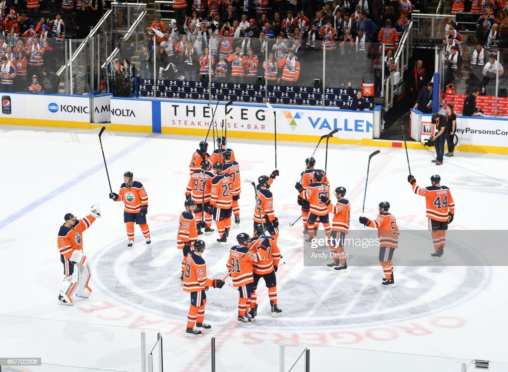 Players of the Edmonton Oilers salute the crowed following the game against the Calgary Flames on October 4, 2017 at Rogers Place in Edmonton, Alberta, Canada.