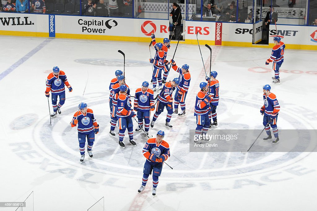 Players of the Edmonton Oilers salute the fans after winning the game against the Winnipeg Jets on December 23, 2013 at Rexall Place in Edmonton, Alberta, Canada.