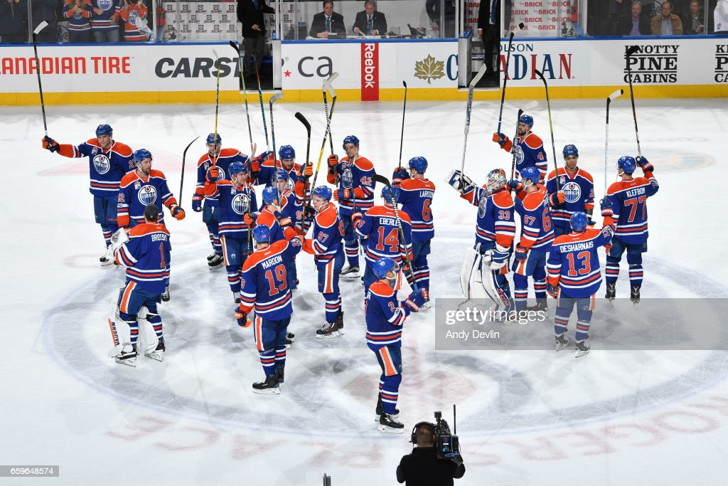 Players of the Edmonton Oilers salute the fans after winning the game against the Los Angeles Kings on March 28, 2017 at Rogers Place in Edmonton, Alberta, Canada.