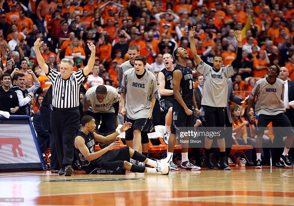 Players of the Georgetown Hoyas celebrate on the bench after a shot made by Otto Porter Jr. #22 during the game against the Syracuse Orange at the Carrier Dome on February 23, 2013 in Syracuse, New York.