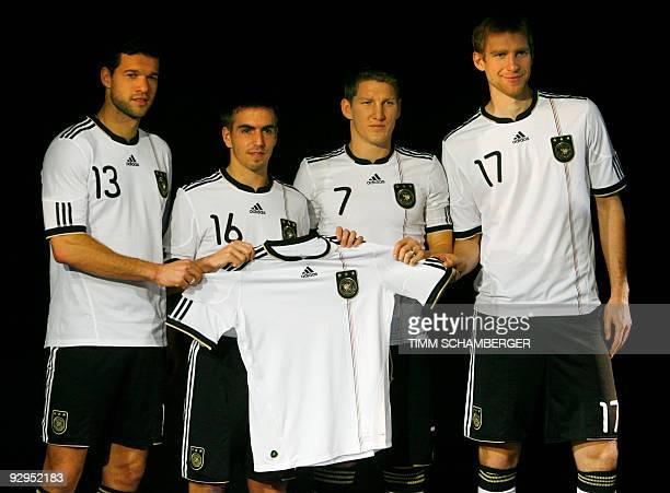Players of the German national football team Michael Ballack Philipp Lahm Bastian Schweinsteiger and Per Mertesacker pose with the German team's...