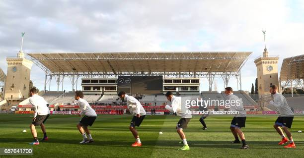 Players of the German National team warm up during a training session of the German National Football team at Tofiq Bahramov Stadium on March 25 2017...