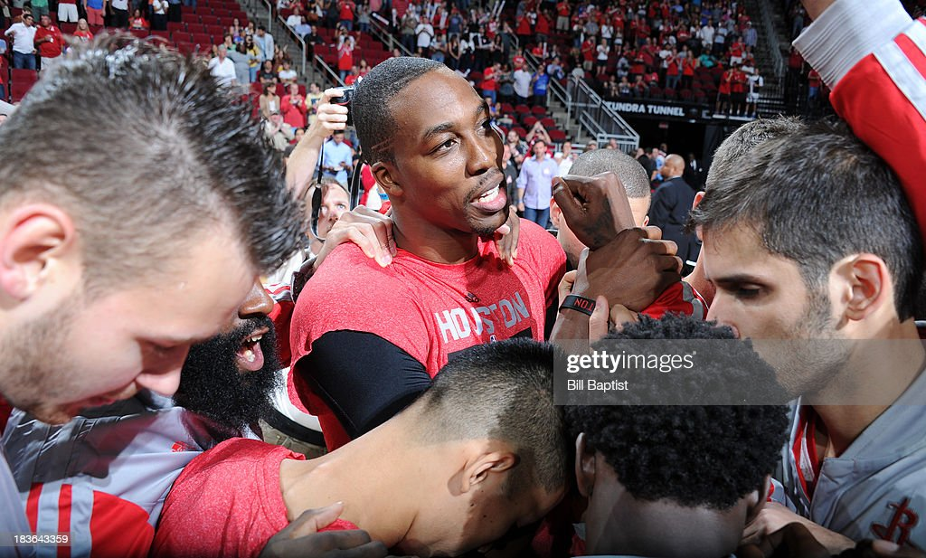 Players of the Houston Rockets huddle before the game against the New Orleans Pelicans before the 2013 NBA pre-season game on October 5, 2013 at the Toyota Center in Houston, Texas.