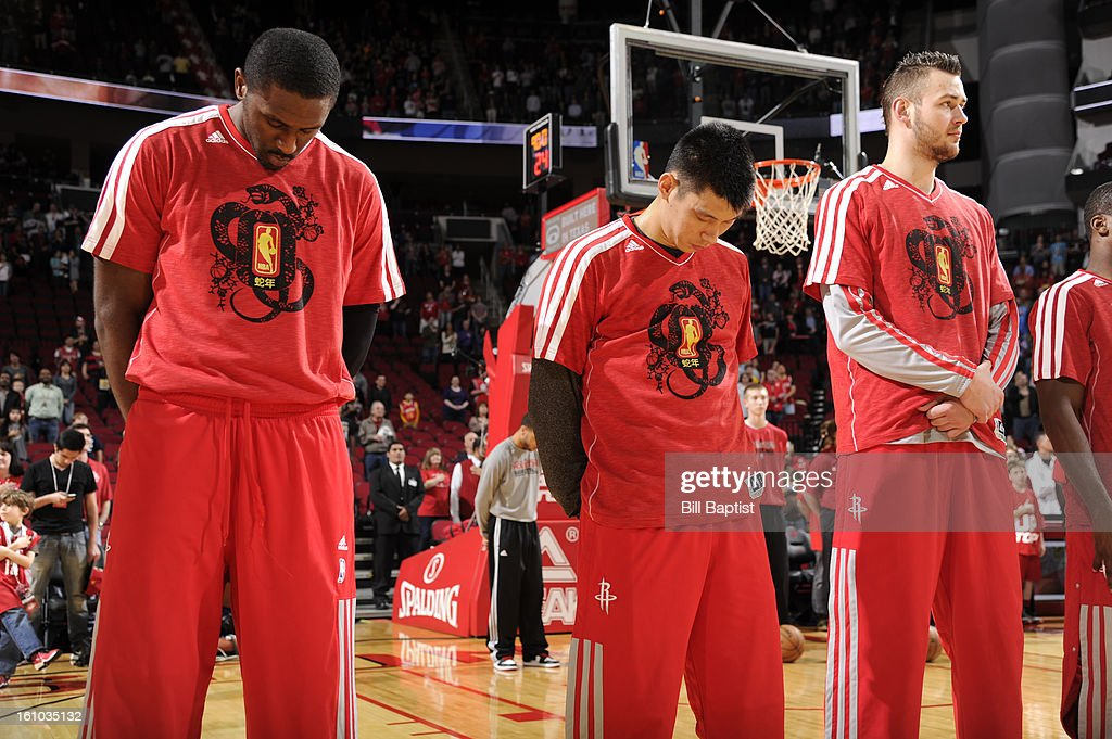 Players of the Houston Rockets wear NBA Chinese New Year shirts during the National Anthem before the game against the Portland Trail Blazers on February 8, 2013 at the Toyota Center in Houston, Texas.