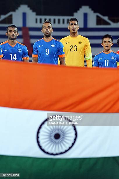 Players of the Indian football team pay respect as the national anthem is played prior to the start of the Asia Group D FIFA World Cup 2018...