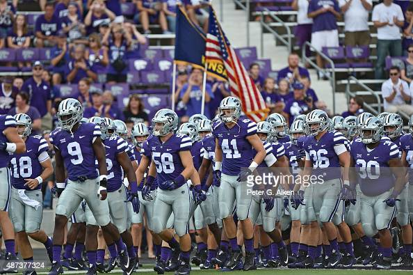 Players of the Kansas State Wildcats enter the field prior to a game against the South Dakota Coyotes on September 5 2015 at Bill Snyder Family...