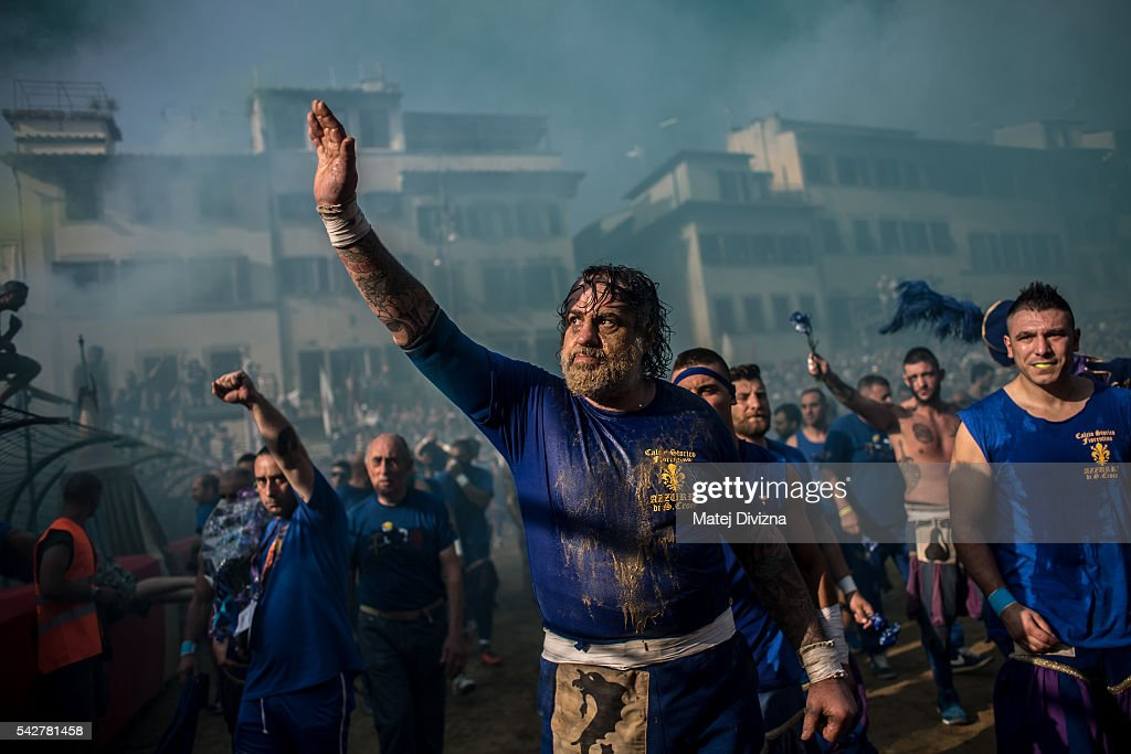 Players of the La Santa Croce Azzuri Team arrive for the final match of The Calcio Storico Fiorentino between the Santo Spirito Bianchi (White) Team and the La Santa Croce Azzuri (Blue) Team at the La Santa Croce square on June 24, 2016 in Florence, Italy. The Calcio Storico (Historical Football in English) Fiorentino is an early form of football, originating in the 1500's. It is a combination of football, rugby and wrestling. Now, annually during a weekend in early June, four teams representing the districts of Florence face each other in the first semi-finals. The winners go to the final, played every year on June 24, the day of the patron of Florence, St. John the Baptist. The official rules of calcio (football) were written for the first time in 1580 by Giovanni de Bardi, a count from Florence. The teams are formed by 27 players and the ball can be played either with hands or feet. Tactics such as punching, elbowing and all martial arts techniques are allowed but kicks to the are forbidden, as are fights of two or more against one. There is a referee, a field master, and six linesmen. The game lasts 50 minutes, and the winning team is the one who scores most points. The playing field is a giant sand pit with a narrow split constructing the goal running the width of each end. The Calcio Storico was not played for 200 years, until its revival in 1930.