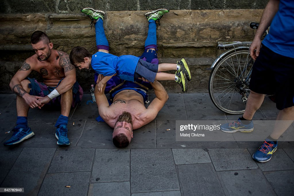 Players of the La Santa Croce Azzuri Team prepare before the final match of The Calcio Storico Fiorentino between the Santo Spirito Bianchi (White) Team and the La Santa Croce Azzuri (Blue) Team in the street on June 24, 2016 in Florence, Italy. The Calcio Storico (Historical Football in English) Fiorentino is an early form of football, originating in the 1500's. It is a combination of football, rugby and wrestling. Now, annually during a weekend in early June, four teams representing the districts of Florence face each other in the first semi-finals. The winners go to the final, played every year on June 24, the day of the patron of Florence, St. John the Baptist. The official rules of calcio (football) were written for the first time in 1580 by Giovanni de Bardi, a count from Florence. The teams are formed by 27 players and the ball can be played either with hands or feet. Tactics such as punching, elbowing and all martial arts techniques are allowed but kicks to the are forbidden, as are fights of two or more against one. There is a referee, a field master, and six linesmen. The game lasts 50 minutes, and the winning team is the one who scores most points. The playing field is a giant sand pit with a narrow split constructing the goal running the width of each end. The Calcio Storico was not played for 200 years, until its revival in 1930.