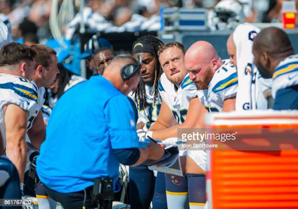 Players of the Los Angeles Chargers talk things over as they take a brief break before going back on the field during the regular season game between...