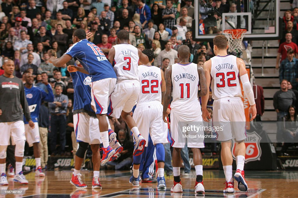 Players of the Los Angeles Clippers celebrate after teammate <a gi-track='captionPersonalityLinkClicked' href=/galleries/search?phrase=Chris+Paul&family=editorial&specificpeople=212762 ng-click='$event.stopPropagation()'>Chris Paul</a> #3 hits the shot to bring them up 3 points against the Utah Jazz at Energy Solutions Arena on December 28, 2012 in Salt Lake City, Utah.