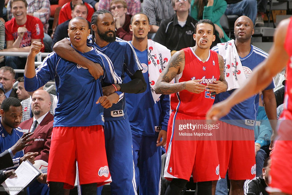 Players of the Los Angeles Clippers celebrate from the sidelines during play against the Utah Jazz at Energy Solutions Arena on December 03, 2012 in Salt Lake City, Utah.