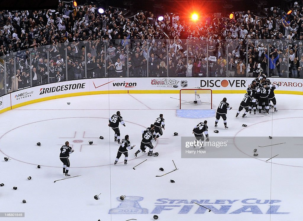 Players of the Los Angeles Kings leave the bench and celebrate with goaltender Jonathan Quick #32 of the Los Angeles Kings after winning Game Six of the 2012 Stanley Cup Final 6-1 to win the Stanley Cup series 4-2 at Staples Center on June 11, 2012 in Los Angeles, California.