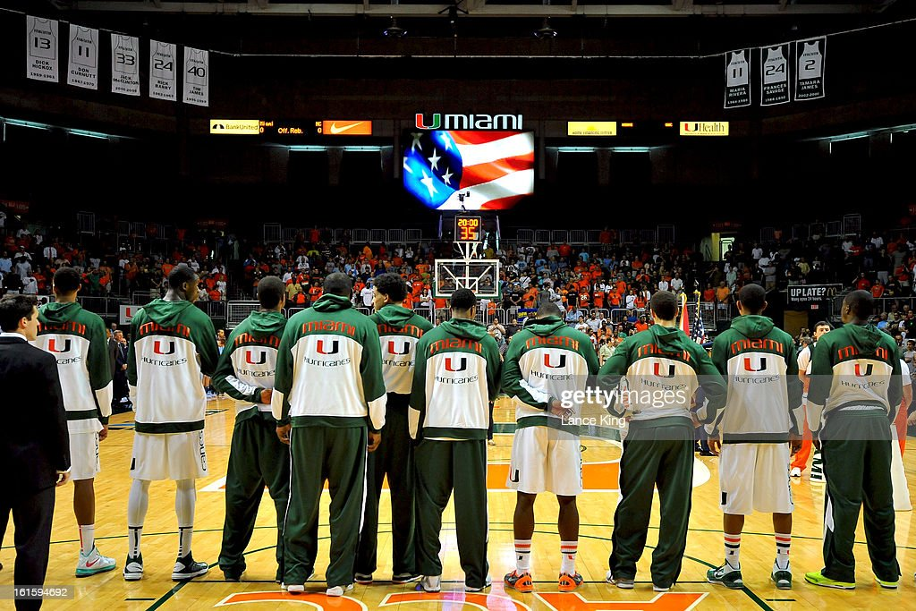 Players of the Miami Hurricanes stand at attention during the National Anthem prior to a game against the North Carolina Tar Heels at the BankUnited Center on February 9, 2013 in Coral Gables, Florida. Miami defeated North Carolina 87-61.