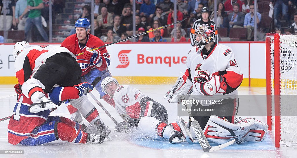 Players of the Montreal Canadiens and of the Ottawa Senators pile up in front of goaltender <a gi-track='captionPersonalityLinkClicked' href=/galleries/search?phrase=Craig+Anderson&family=editorial&specificpeople=211238 ng-click='$event.stopPropagation()'>Craig Anderson</a> #41 in Game Two of the Eastern Conference Quarterfinals during the 2013 NHL Stanley Cup Playoffs at the Bell Centre on May 3, 2013 in Montreal, Quebec, Canada.