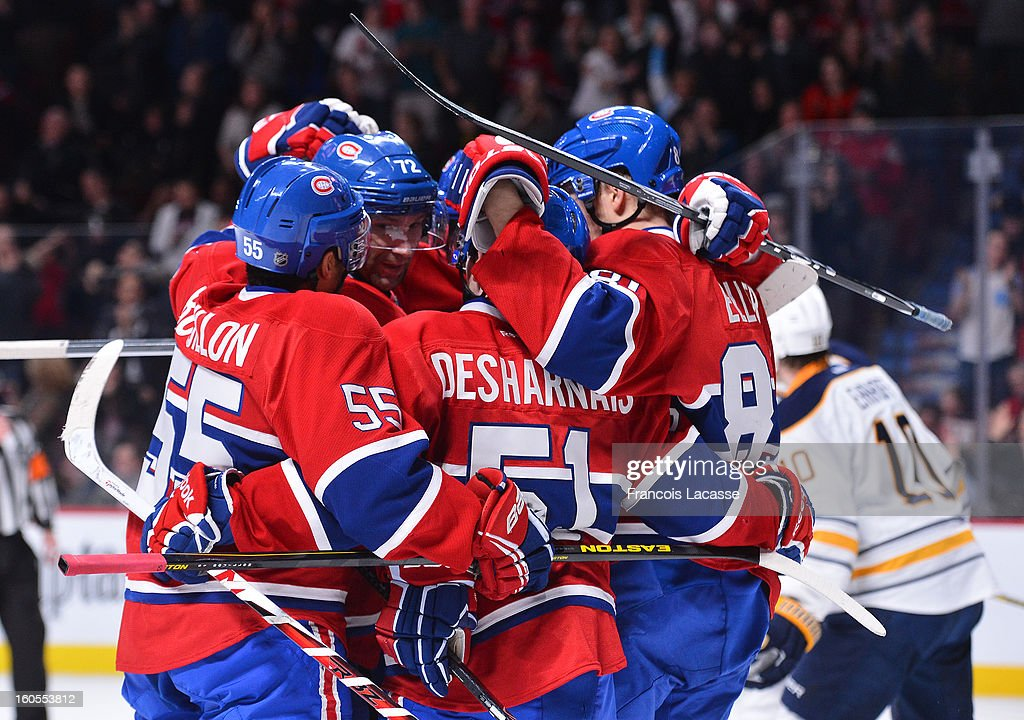 Players of the Montreal Canadiens celebrate a goal during the NHL game against the Buffalo Sabres on February 2, 2013 at the Bell Centre in Montreal, Quebec, Canada.