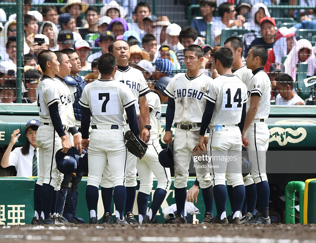 Players of the Nagasaki Commercial High School baseball team observe a moment of silence during its firstround game of the national championship at...