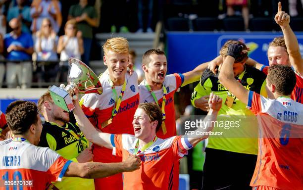 Players of The Netherlands celebrate after winning the men's final match between The Netherlands and Belgium at The European Hockey Championship in...