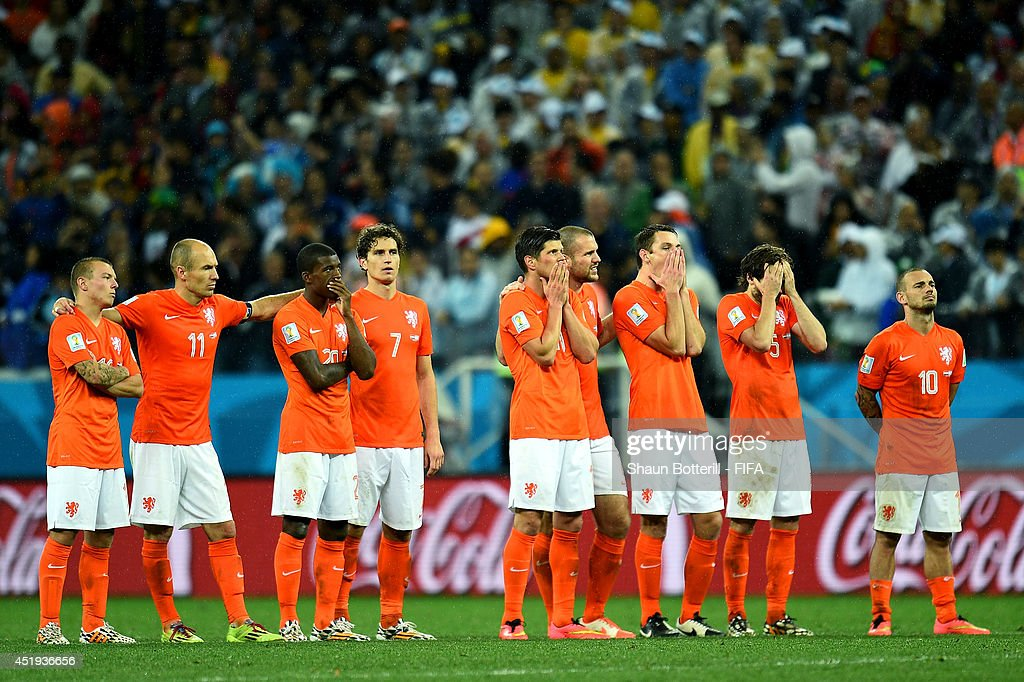 Players of the Netherlands watch the penalty shootout during the 2014 FIFA World Cup Brazil Semi Final match between Netherlands and Argentina at Arena de Sao Paulo on July 9, 2014 in Sao Paulo, Brazil.