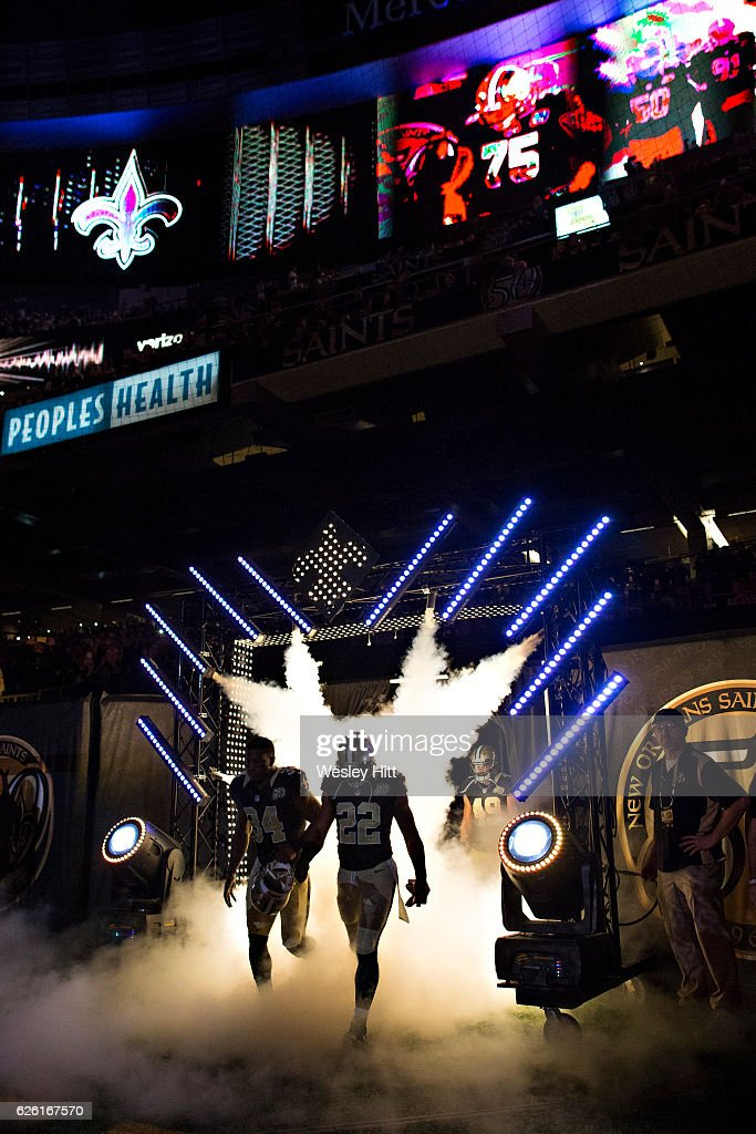 Players of the New Orleans Saints run onto the field before a game against the Los Angeles Rams at Mercedes-Benz Superdome on November 27, 2016 in New Orleans, Louisiana. The Saints defeated the Rams 49-21.