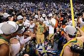 Players of the Notre Dame Fighting Irish celebrate following their victory against the North Carolina Tar Heels during the finals of the 2015 Men's...