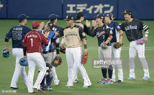 Players of the Pacific League celebrate after defeating the Central League 62 in the AllStar Game 1 at Nagoya Dome on July 14 2017 ==Kyodo