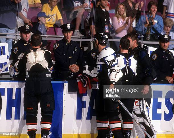 Players of the Philadelphia Flyers shake hands with officers of the New York Police Department after the attacks that occured on September 11 in New...