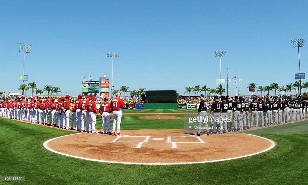 Players of the Philadelphia Phillies and the New York Yankees line up for pregame introductions February 27 2011 at Bright House Field in Clearwater...