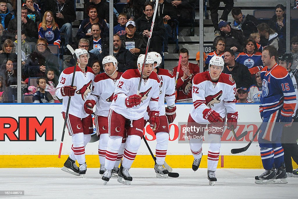 Players of the Phoenix Coyotes celebrate after scoring a goal in game against the Edmonton Oilers on February 23, 2013 at Rexall Place in Edmonton, Alberta, Canada.