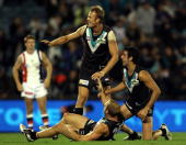 Players of the Power celebrate winning the game during the round five AFL match between the Port Adelaide Power and the St Kilda Saints at AAMI...