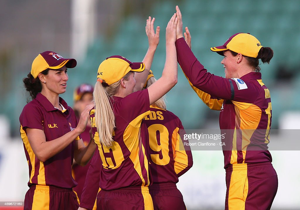 Players of the Queensland Fire celebrate a wicket during the WT20 match between Tasmania and Queensland Aurora Stadium on November 28 2014 in...