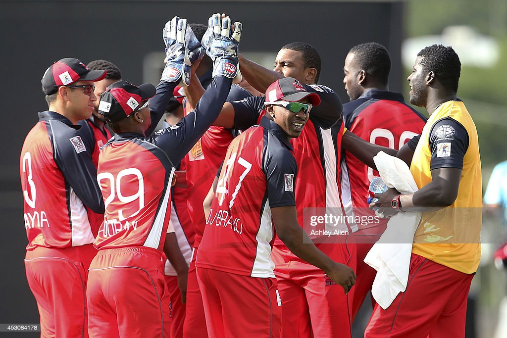 Players of The Red Steel celebrate during a match between St. Lucia Zouks and The Trinidad and Tobago Red Steel as part of week 4 of the Limacol Caribbean Premier League 2014 at Beausejour Stadium on August 02, 2014 in Castries, St. Lucia.