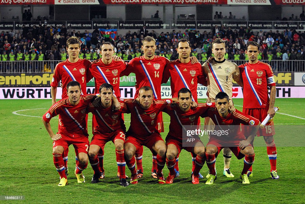 Players of the Russian national team pose for photographers prior to the FIFA World Cup 2014 qualifying football match between Azerbaijan and Russia in Baku on October 15, 2013.