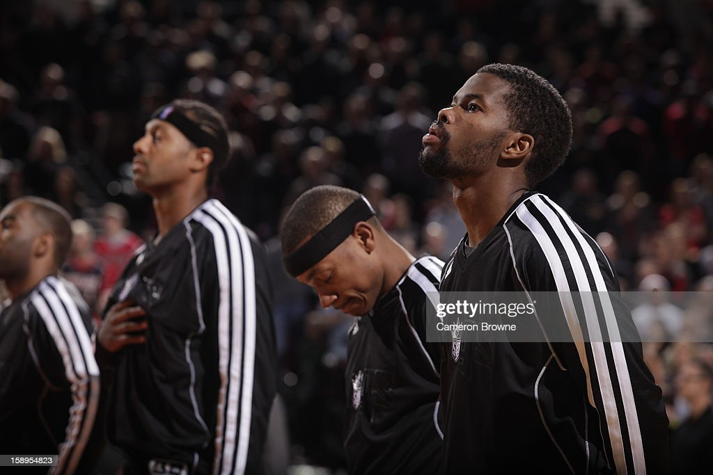 Players of the Sacramento Kings take part in the National Anthem before the game against the Portland Trail Blazers on December 26, 2012 at the Rose Garden Arena in Portland, Oregon.