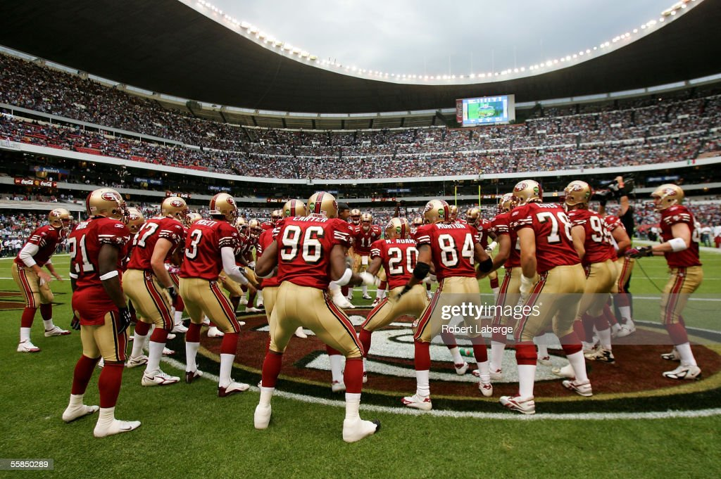 Players of the San Francisco 49ers cheer each other on before the start of the NFL game against the Arizona Cardinals at Estadio Azteca in Mexico City, Mexico. The Cardinals won 31-14.