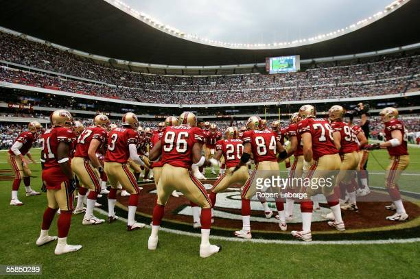 Players of the San Francisco 49ers cheer each other on before the start of the NFL game against the Arizona Cardinals at Estadio Azteca in Mexico...